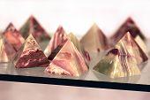image of triangular pyramids  - stone pyramids of onyx in a glass case  - JPG