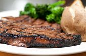 stock photo of t-bone steak  - a delicious t-bone steak grilled to perfection ** Note: Shallow depth of field - JPG