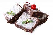 image of brownie  - chocolate cake brownie with walnuts and cherries close - JPG