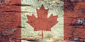stock photo of birching  - A Canada flag layered over birch bark texture - JPG