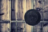 picture of sawing  - Background image of four different sized circular saw blades hanging on a nail on a wall made of wooden boards - JPG