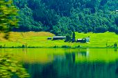 stock photo of fjord  - Norwegian country house hytte in the mountains - JPG