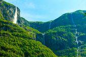 foto of fjord  - Summer mountain beautiful waterfall in Norway fjords Europe - JPG