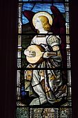 stock photo of church mary magdalene  - A Victorian stained glass window depicting an angel playing the lute - JPG