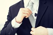stock photo of snatch  - close up of mans hand hiding ace in the jacket pocket - JPG