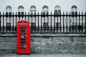 foto of architecture  - Red telephone box in street with historical architecture in London - JPG