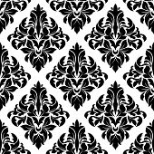 stock photo of tendril  - Black and white damask seamless background with lush foliage composition of bold pointed leaves and curly tendrils suitable for upholstery fabric or hangings design - JPG