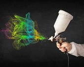 stock photo of airbrush  - Painter working with airbrush and paints colorful paint concept - JPG