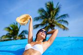 stock photo of woman bikini  - Young woman relaxing and enjoying at beach during tropical caribbean vacation travel - JPG
