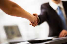 stock photo of handshake  - Business people shaking hands finishing up a meeting - JPG