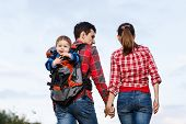 image of chassis  - Baby boy in backpack carrier on walking tour - JPG