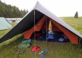 foto of sleeping bag  - big tent of boy scout campsite with backpacks and sleeping bags spread out - JPG