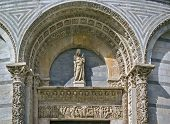 pic of building relief  - sculpture and relief over the entrance in Pisa Baptistry Italy - JPG