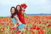 foto of preteens  - Mother and her 7 years old preteen child playing in spring flower field - JPG