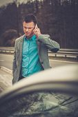 foto of pick up  - Man calling while tow truck picking up his broken car  - JPG