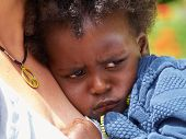 image of bad mood  - Adorable black sad baby crying in a bad mood - JPG