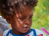 stock photo of bad mood  - Adorable black sad baby crying in a bad mood - JPG