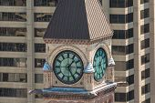 stock photo of city hall  - Old City Hall Clock Tower against a modern building background the Old City Hall is a heritage building and a major tourist attraction - JPG