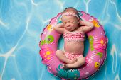 picture of sleeping beauty  - A portrait of a beautiful eleven day old baby girl wearing a pink polka dot bikini - JPG