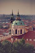 image of nicholas  - Prague Saint Nicholas Church located on Mala Strana PArt of the Old Town Retro Toned Image - JPG