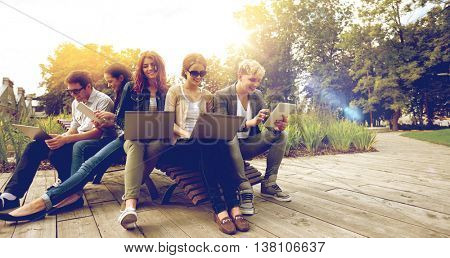 summer, communication, technology , education and teenage concept - group of students or teenagers w