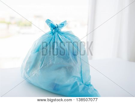 waste recycling, reuse, garbage disposal, environment and ecology concept - close up of rubbish bag