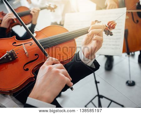 Confident violinist playing