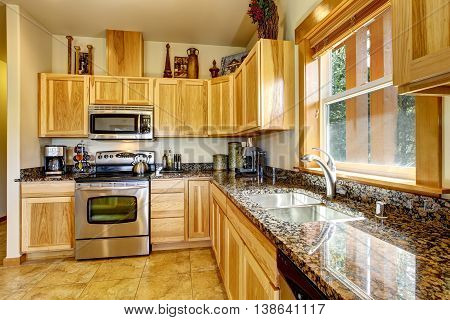 Nicely Decorated Kitchen Room Interior With Modern Cabinets And Tile Floor