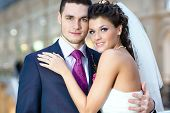 image of wedding couple  - Portrait of Young beautiful wedding couple indoors  - JPG