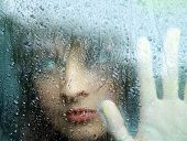 stock photo of young girls  - Sad young woman and a rain drops - JPG