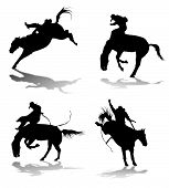 stock photo of bucking bronco  - Four silhouettes of cowboys participating in rodeo - JPG