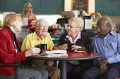 pic of senior adult  - Senior adults having morning tea together - JPG