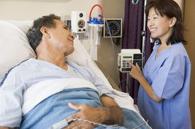 stock photo of hospital patient  - Doctor And Patient Talking To Each Other - JPG