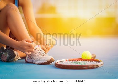 poster of Sport Tennis Player Tying Shoelaces In Court. Sunset Sport Tennis Player Racket. Sport Tennis Player