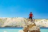 Mountain Biker Looking At View And Traveling On Bike In Summer Sea Landscape. Man Riding A Bicycle I poster
