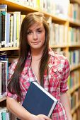 Portrait Of A Cute Female Student Holding A Book