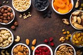 Assortment Of Nuts And Dried Fruits In Bowls. Cashew, Hazelnuts, Walnuts, Almonds, Brazilian Nuts, R poster