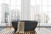 Luxury Bathroom Interior With A Dark Wooden Floor, White Walls, And A Black Bathtub. A Beautiful Cit poster