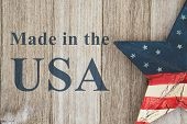 Made In The Usa Message, Usa Patriotic Old Flag On A Star With Weathered Wood Background With Text M poster