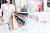 Happy Brunette With Shopping Bags At Mall. Sale. Shopping Concept. Consumerism Concept. poster