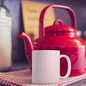 White Coffee Mug Mockup In A Kitchen Setup With A Red Kettle. Great For Overlaying Your Custom Quote poster