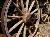 picture of western nebraska  - Vintage wooden wagonwheel showing it - JPG