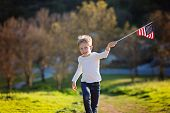 Positive Little Boy With American Flag Running And Celebrating 4th Of July, Independence Day, Or Mem poster