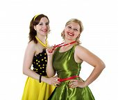 foto of poodle skirt  - two stylish young woman in bright colour dresses - JPG