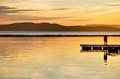 stock photo of burlington  - Two lovers share a moment on Lake Champlain - JPG