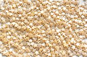 Yellow Stars Sprinkles As Background, Top View. Sugar Pearl Pastel Cake Sprinkles Close Up. poster