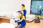 Professional Cleaning Service. Two Women In Working Uniform, In Aprons. Two Women In Working Uniform poster