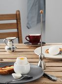 Two Soft-boiled Eggs, White Eggs On A Wooden Brown Table. Gray Ceramic Plate With Soft-boiled Egg, F poster