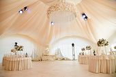 Wedding Ceremony In A Beautiful Tent. Hall With Dining Tables Decorated With Bouquets Of Flowers. poster