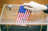 Man Inserting Flag Of United States Of America Into Ballot Box, Voting And Elections In United State poster